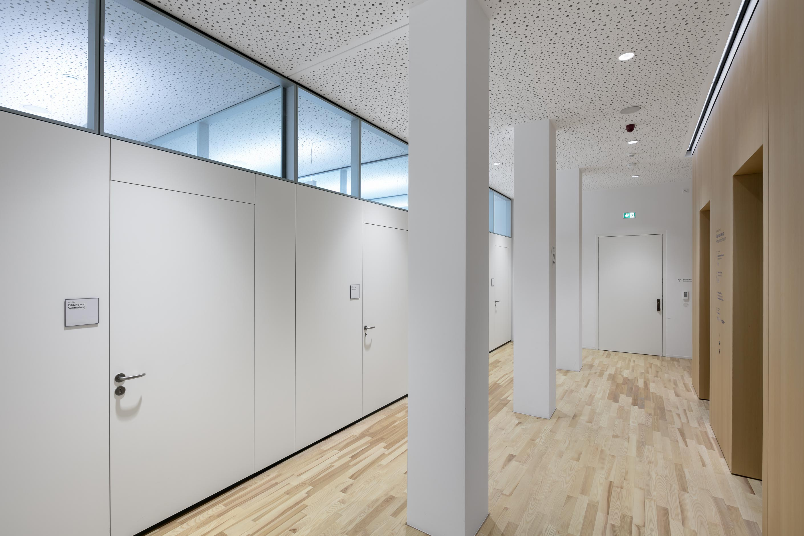 Flush wooden door elements with concealed frames on the corridor side